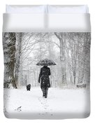 Woman Walking In A Snowy Forest Duvet Cover