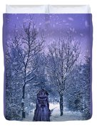Woman Walking In Snow Duvet Cover by Amanda Elwell