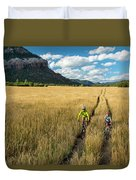 Woman With Daughter Riding Mountain Duvet Cover