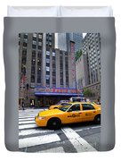Yellow Cabs Pass In Front Of Radio City Music Hall Duvet Cover