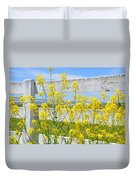 Yellow Flowers And A White Fence Duvet Cover