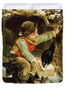 Young Boy With Birds In The Snow Duvet Cover