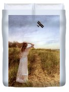 Young Lady In Vintage Clothing Watching A Biplane Duvet Cover