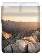 Young Man Scrambles To The Summit Duvet Cover