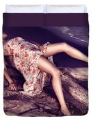 Young Woman In Dress Lying On Driftwood On A Shore Duvet Cover