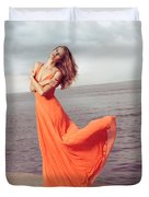 Young Woman In Orange Dress Flying In The Wind At Sea Shore Duvet Cover by Oleksiy Maksymenko