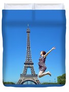 Young Woman Jumping Against Eiffel Tower Duvet Cover