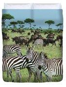 Zebra And Wildebeest Grazing Masai Mara Duvet Cover