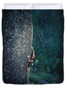 A Rock Climber In Montanas Hyalite Duvet Cover