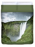 A Waterfall Over A Grassy Cliff Duvet Cover