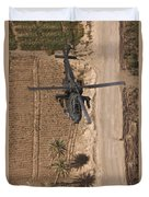 An Ah-64d Apache Helicopter In Flight Duvet Cover