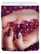 Woman Hand With Purple Nail Polish On Candy Duvet Cover