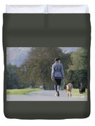 Woman Walking With Her Dogs Duvet Cover