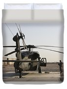 A Uh-60 Black Hawk Helicopter Parked Duvet Cover