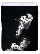 An Astronaut Anchored To A Mobile Foot Duvet Cover