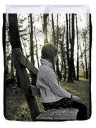 Girl Sitting On A Wooden Bench In The Forest Against The Light Duvet Cover
