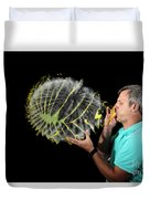 Man Over-inflating Balloon Duvet Cover
