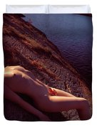 Nude Woman Lying On Rocks By The Water Duvet Cover