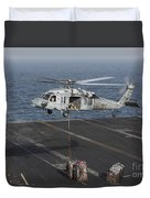 A Mh-60s Knighthawk Conducts A Vertical Duvet Cover