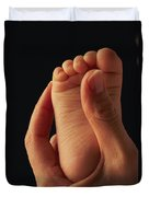 A Babys Foot In An Adult Hand Duvet Cover