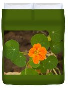 A Beautiful Orange Trumpet Shaped Flower With Green Leaves Duvet Cover