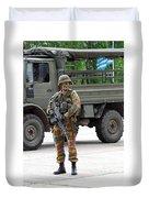 A Belgian Infantry Soldier Handling Duvet Cover by Luc De Jaeger
