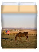 A Brown Horse Grazing In A Field In Duvet Cover by Michael Interisano