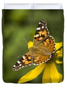 A Butterfly Sits Atop A Yellow Duvet Cover