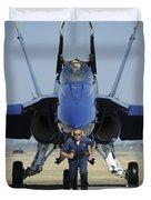A Crew Chief Sprints Ahead Of A Blue Duvet Cover