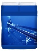 A Crewman Cranks Out The Dry Deck Duvet Cover by Michael Wood