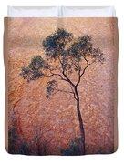A Desert Bloodwood Tree Against The Red Duvet Cover