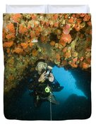 A Diver Explores A Cavern With Orange Duvet Cover