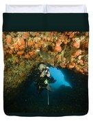 A Diver Explores A Cavern With Orange Duvet Cover
