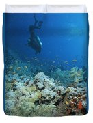 A Diver Explores Coral And Marine Life Duvet Cover