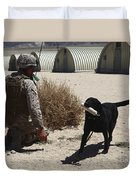 A Dog Handler Calls Over A Black Duvet Cover by Stocktrek Images