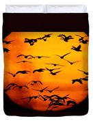 A Flock Of Geese Is Silhouetted Duvet Cover