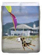 A German Shepherd Leaps For A Kite Duvet Cover