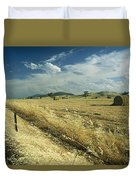 A Hay Field With Bales Sitting Duvet Cover