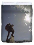 A Hiker Rests Atop A Huge Granite Duvet Cover