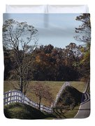 A Hilly Country Road Passes A Fenced Duvet Cover