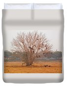 A Leafless Tree That Is Home To A Large Number Of Big Birds In The Middle Of A Ground Duvet Cover