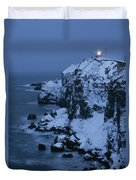 A Lighthouse Atop Snow-covered Cliffs Duvet Cover