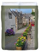 A Line Of Flowers In A French Village Duvet Cover