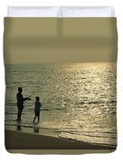 A Man And A Young Boy Fish In The Surf Duvet Cover