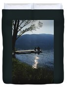 A Man And His Dog On A Lake Skaha Dock Duvet Cover