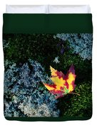 A Maple Leaf Lies On A Bed Of Moss Duvet Cover