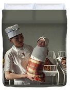 A Nurse Holds A Tightly Wrapped Newborn Duvet Cover