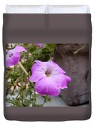 A Photo Of A Purple Trumpet Shaped Flower Duvet Cover