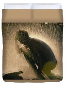 A Silhouetted Man Cooling Off In Water Duvet Cover