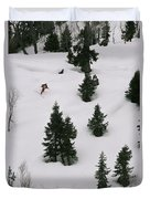 A Skier Makes His Way Down A Hill Duvet Cover